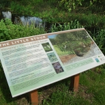 Wide format frameless panel with river cross-section illustration